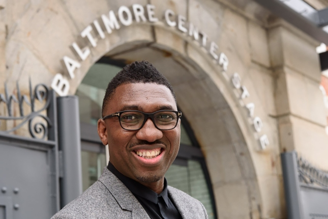 A photo of Kwame Kwei-Armah taken outside the entrance to Baltimore Centre Stage